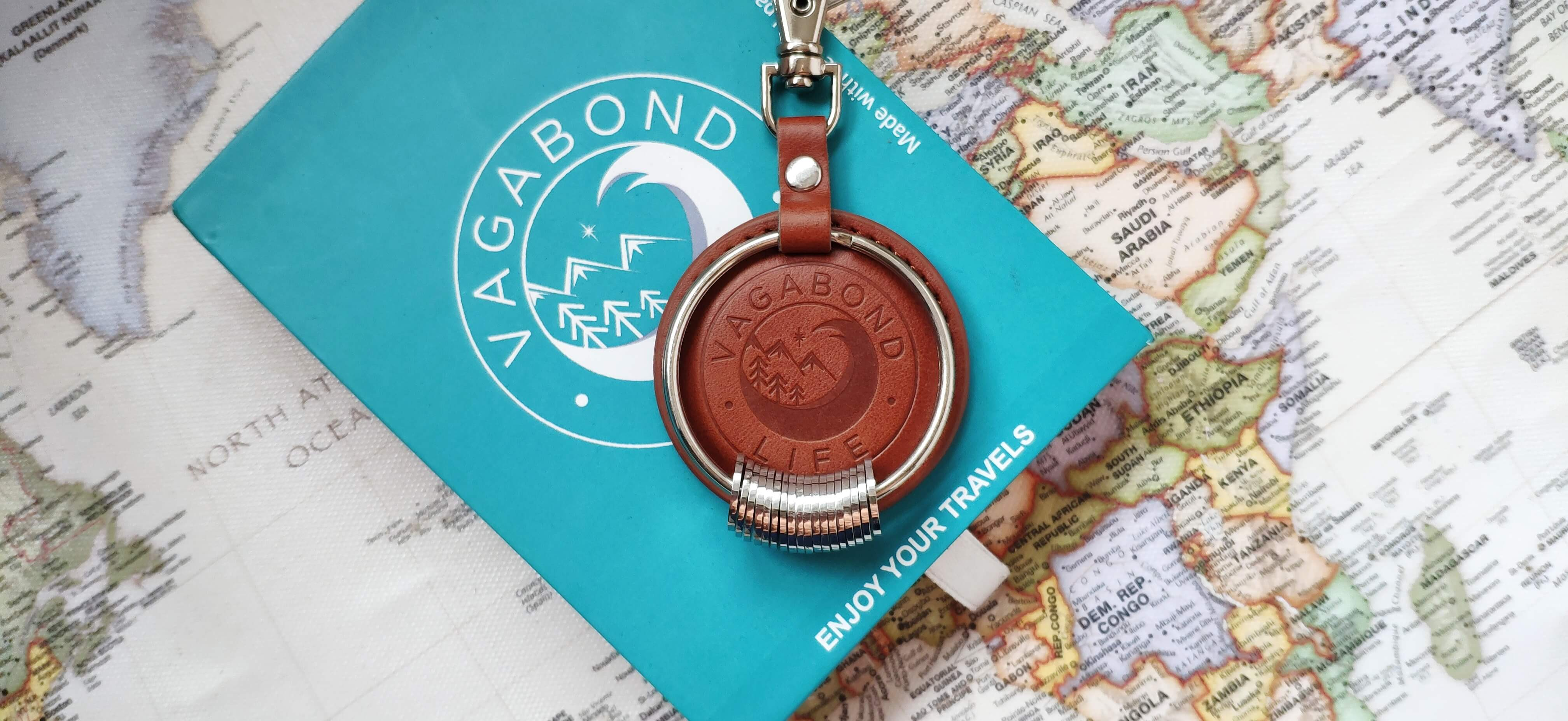 Keychain with box on world map background