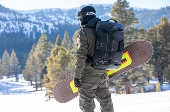 Snow boarder wearing backpack
