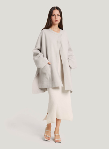 Wrap yourself in the feminine charms of this wool coat. This coat features a clean-lined silhouette tailored from a touch of soft pure wool that creates a sweeping drape.  – 100% Wool