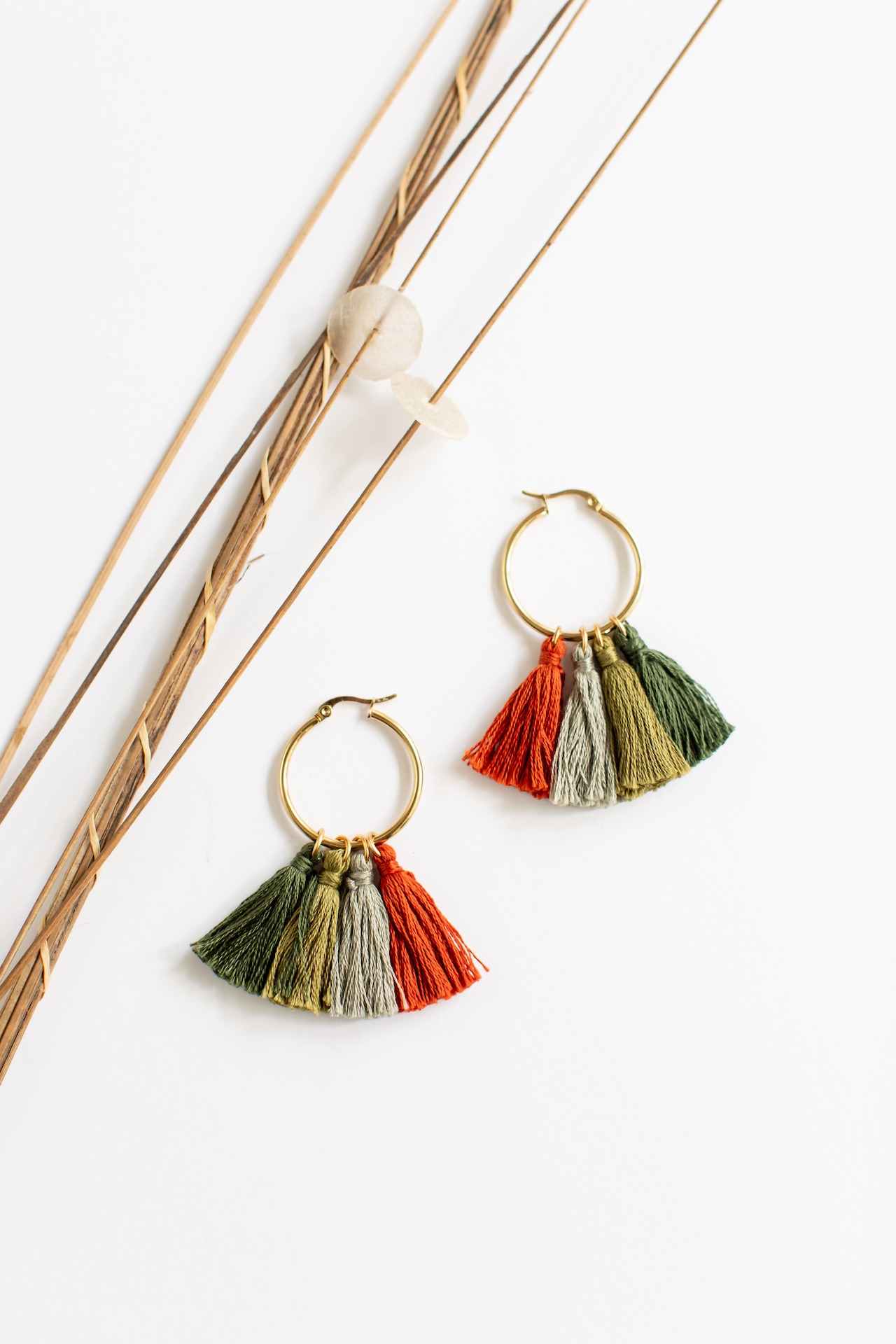 What is better than enjoying the beautiful colors of autumn? Taking the vibrant hues of fall with you and wearing them as an accessory! With these Festivus Tassel Earrings, you can sport an Autumn inspired pallet in fair trade and fashionable way. When yo