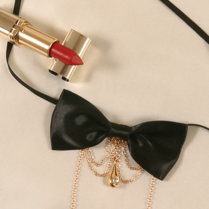 Black bow with gold chain and jewel g-string