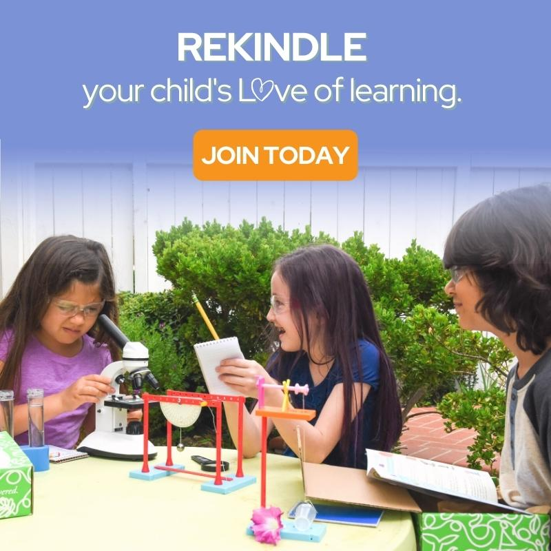 Two kids doing a science experiment with their science kit box from Green Kid Crafts