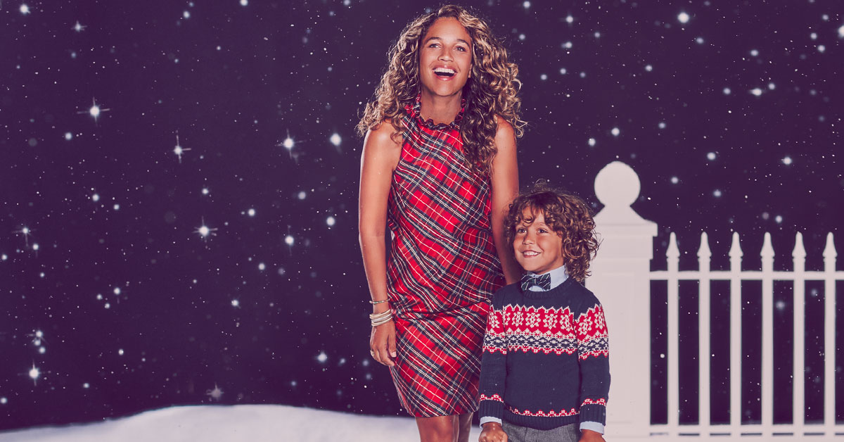 Mother & Children photos mother and son in holiday clothing at night stars by fence snow
