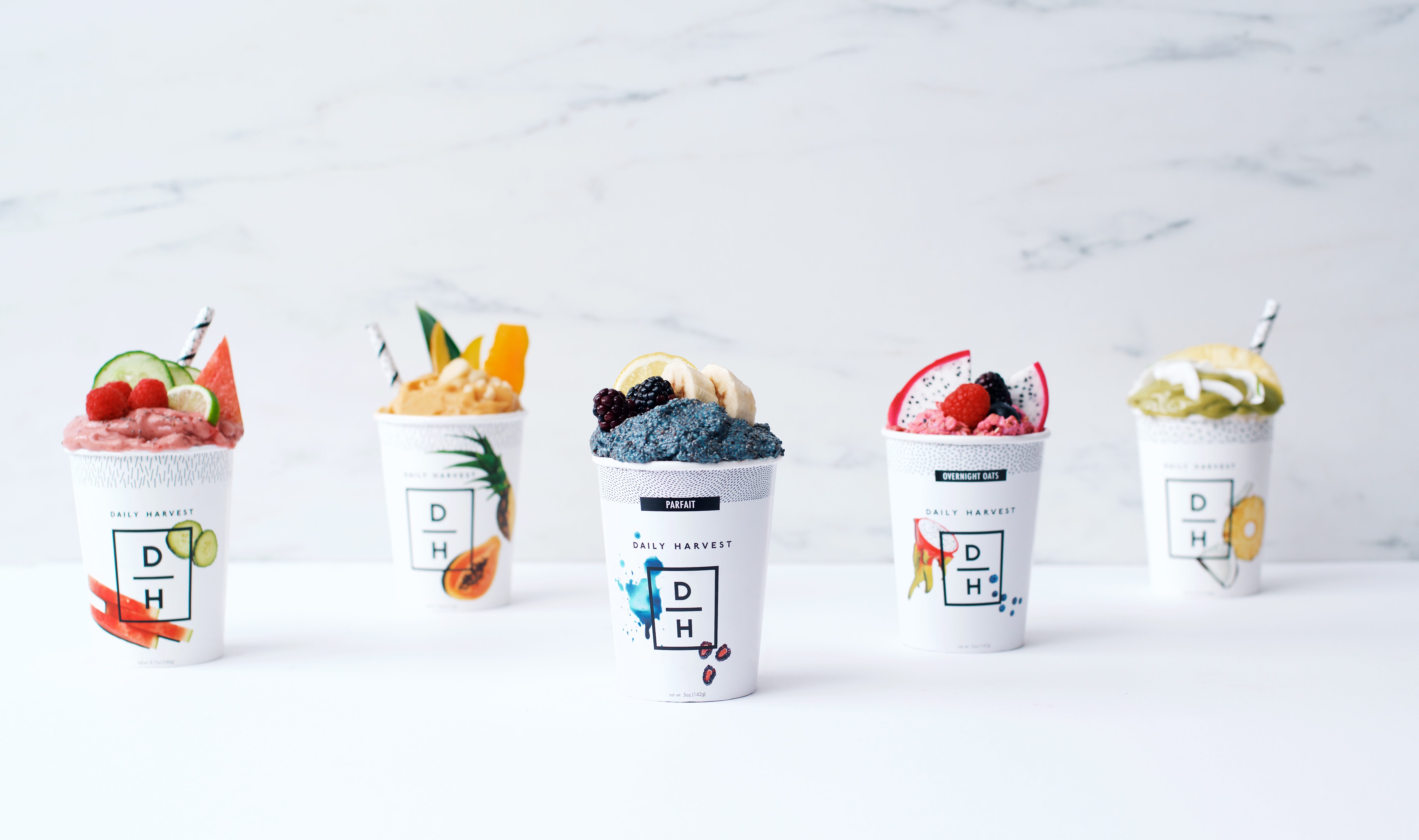 A variety of Daily Harvest cups on a counter