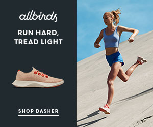 A woman running down a hill wearing Allbirds sustainably-made shoes.