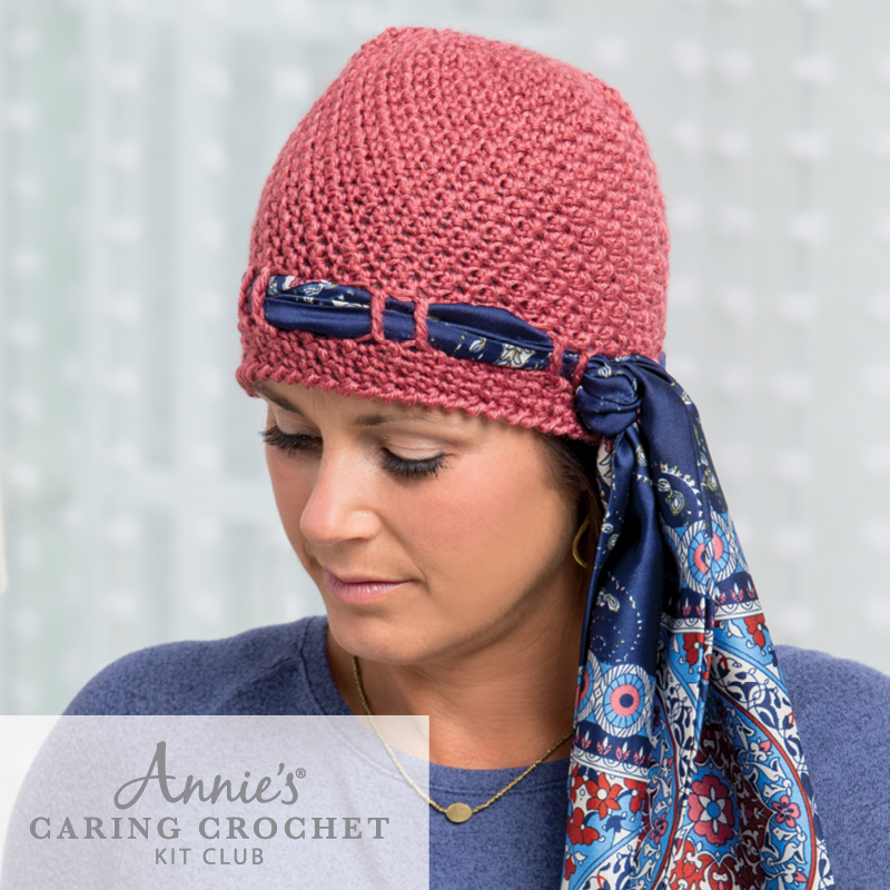 woman wearing pink chemo hat with scarf trimming-Annie's Caring Crochet