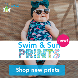 Shop i play. 2019 Swim and Sun Wear Prints! [cute little girl in navy and pink flamingo swimsuit]